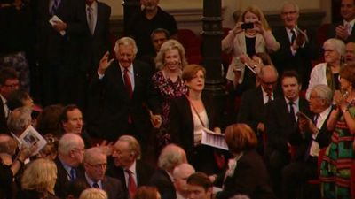 Bob Hawke waves to the crowd.
