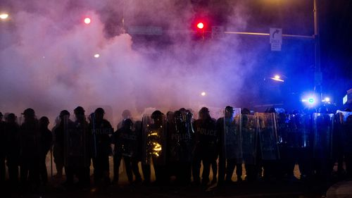 Police took the streets before the curfew was to be enacted, urging people to go home. (AAP)