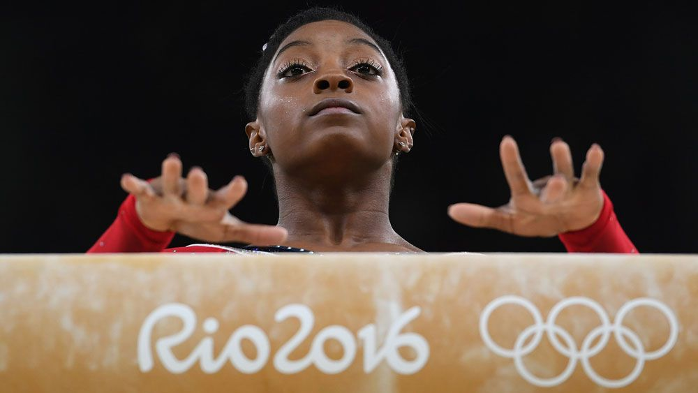 Simone Biles had to settle for silver on the beam. (Getty Images)