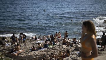 In this, July 25, 2020, file photo, people enjoy the sun at the Malmousque Beach in Marseille, in southern France.