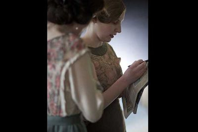Michelle Dockery (Mary Crawley) and Laura Carmichael (who plays her sister Edith) fill in the time between takes with with a crossword.