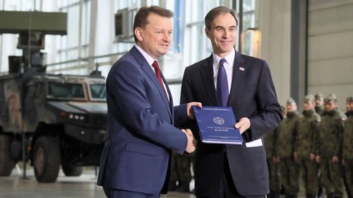 Polish Defence Minister Mariusz Blaszczak , left, and United States Ambassador to Poland Paul W. Jones during a ceremony of signing a contract for the purchase of US Patriot air and missile defence system in Warsaw. (Photo: AP).