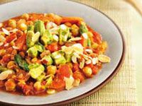 Chickpeas in spicy sauce with avocado salsa and avocado gravy