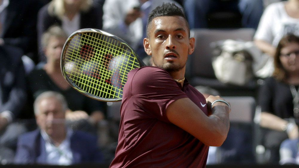 Kyrgios goes down fighting to Nadal