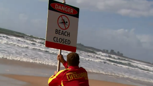 Surf lifesaving Queensland are urging people to stay safe with beaches closed due to dangerous surf and strong winds.