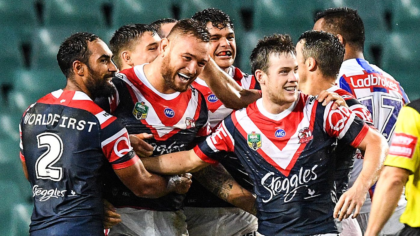 Jared Waerea-Hargreaves (centre) of the Roosters celebrates a try
