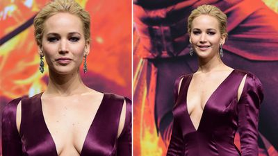 Actress Jennifer Lawrence poses for photographers in a plunging purple gown. (AFP)