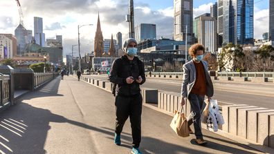 Pedestrians walk away from the central business district in Melbourne.