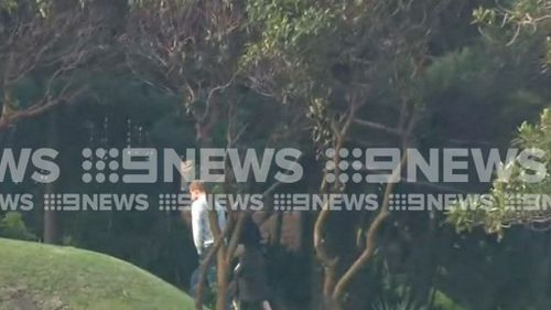 After a day laying low, the couple have been spotted by 9NEWS cameras strolling on the lawns of Admiratly House.