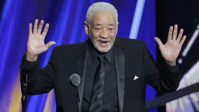 This April 18, 2015 file photo shows singer-songwriter Bill Withers speaking at the Rock and Roll Hall of Fame Induction Ceremony in Cleveland.