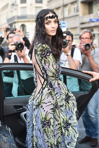 <p>Mariacarla Boscono liked the runway look so much she left the show in a Versace gown and the flower crown.</p>