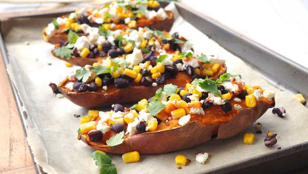 Loaded sweet potatoes with feta, corn and black beans