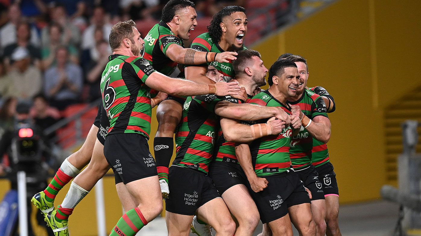 Cody Walker of the Rabbitohs celebrates with team mates after scoring a try during the NRL Preliminary Final match between the South Sydney Rabbitohs and the Manly Sea Eagles at Suncorp Stadium on September 24, 2021 in Brisbane, Australia. (Photo by Bradley Kanaris/Getty Images)