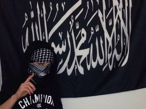 A teenage boy poses with the Mohammad's flag of Jihad (Instagram).