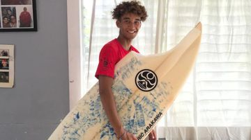 A shark took a huge chunk out of his surfboard