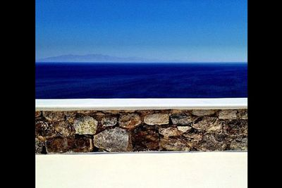 Sapphire blue water, ancient stone walls and idyllic weather. Greece!