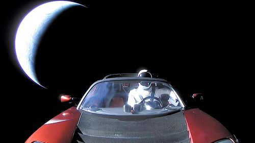The spectacular final image of the Tesla in space and its mannequin 'driver'. (Photo: EPA).