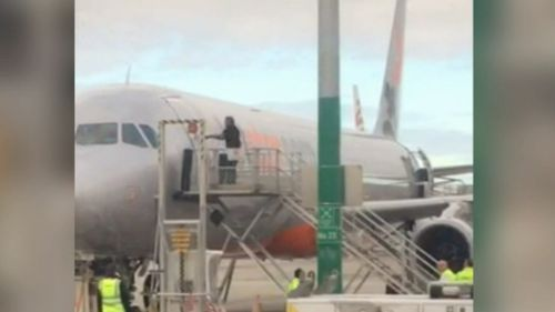 A man has been arrested after attempting to break into a Jetstar plane at Melbourne Airport. (9NEWS)