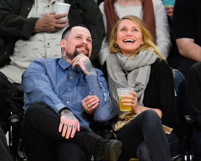 Benji Madden  and Cameron Diaz attend a basketball game between the Washington Wizards and the Los Angeles Lakers at Staples Center on January 27, 2015 in Los Angeles, California.