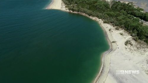 A sinkhole has opened up on a popular Queensland beach.