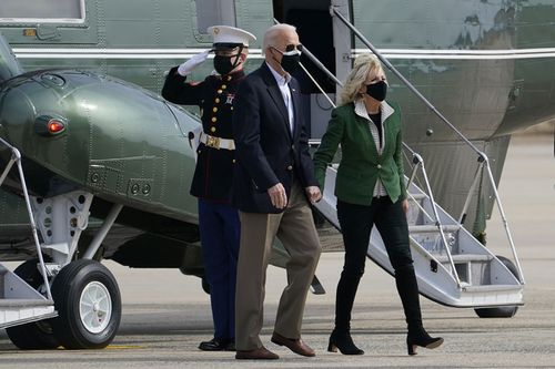 President Joe Biden and first lady Jill Biden walk from Marine One towards Air Force One at Andrews Air Force Base, Md., Friday, Feb. 26, 2021.