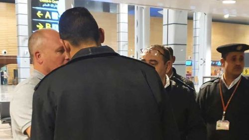 Tony Remo Camoccio is confronted by security officers after he patted one on the back.