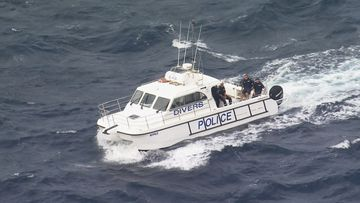 NSW Police divers searching the waters near Dover Heights in Sydney's east today.