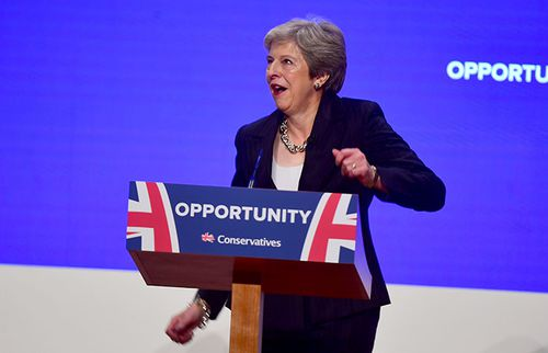 Theresa May continues her jig after arriving at the podium on stage.