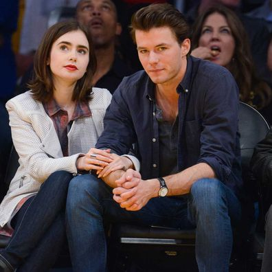 Lily Collins and Thomas Cocquerel attend a basketball game between the Chicago Bulls and the Los Angeles Lakers at Staples Center on February 9, 2014.