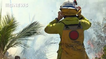 Backburning crews working to protect homes from bushfire