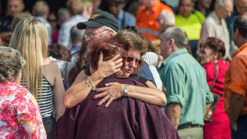 """Family and friends mourn following the funeral service of Margaret Louisa Clark (82), the second person to die from injuries of the Ravenshoe """"Serves You Right Cafe"""" gas explosion. (AAP)"""