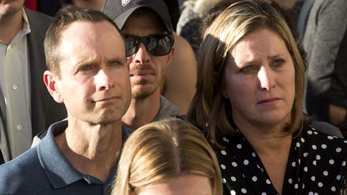 Matt and Jill McCluskey, parents of Lauren McCluskey attend a vigil for their daughter.