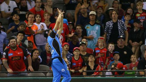 Ben Laughlin of the Strikers catches Dwayne Bravo of the Renegades near the boundary