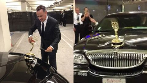 Watch: Tom Hanks pimps his ride by sticky-taping his Emmy to the hood