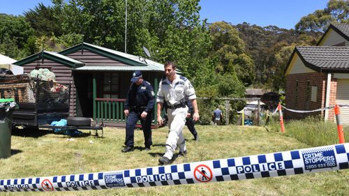 New South Wales police are seen on the property where Belinda Peisley last lived in Katoomba, New South Wales, Monday, December, 3, 2018.