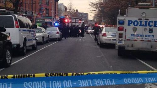 Emergency services on the scene of a police shooting in Brooklyn, New York. (Twitter)