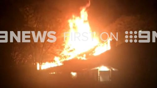 Neighbours reported huge flames leaping into the sky, fearing the blaze would spread. (9NEWS)
