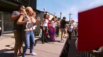 The stars of this season of The Block, on stage to welcome the crowds who had come to inspect their hard work. (9NEWS)
