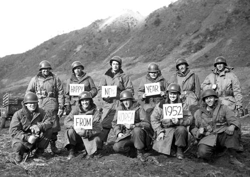 Missouri soldiers from the 19th Infantry Regiment pose for a group portrait, along the Kumsong front, to wish folks back home a Happy New Year, during the Korean War, December 1951. (Photo by Interim Archives/Getty Images)