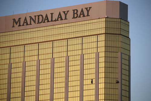 Drapes billow out of broken windows at the Mandalay Bay resort and casino on the Las Vegas Strip, following a deadly shooting at a music festival in Las Vegas. Stephen Paddock, 64, fired more than 1,100 rounds of ammunition from his suite on the 32nd floor of the Mandalay Bay Hotel on the night of October 1, 2017. It took 11 minutes for him to kill 58 people and wound more than 400.