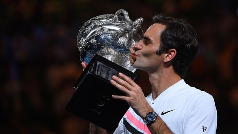 Roger Federer of Switzerland celebrates after winning the 2018 Australian Open