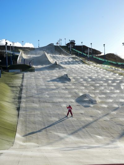 January 13, 2016 - A skier uses the synthetic slope at Noeux-les-Mines in northern France, 600kms from the mountains. The slopes use sprayed water for their operation. (Denis Charlet/AFP)