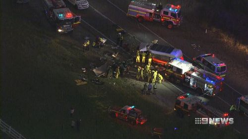 Police were forced to close the road in both directions. (9NEWS)