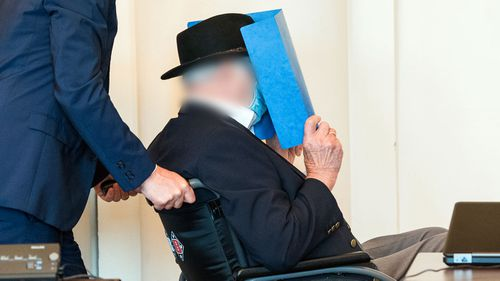 Bruno Dey, 93-year-old former SS security guard from the Stutthof concentration camp near Gdansk sits in a courtroom behind a plexiglass window in the regional court on July 23, 2020 in Hamburg, Germany.