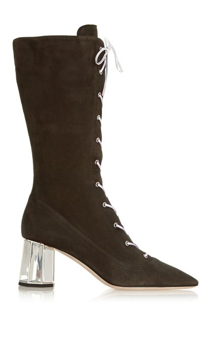 "<a href=""http://www.net-a-porter.com/product/524517/Miu_Miu/metallic-detailed-suede-boots"" target=""_blank"">Metallic-Detailed Suede Boots, $955, Miu Miu, net-a-porter.com</a>"