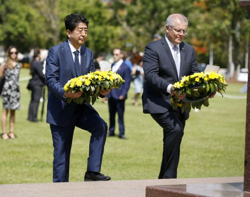 Shinzo Abe and Scott Morrison laid wreaths at the Darwin Cenotaph, 77 years after Japan bombed the city.