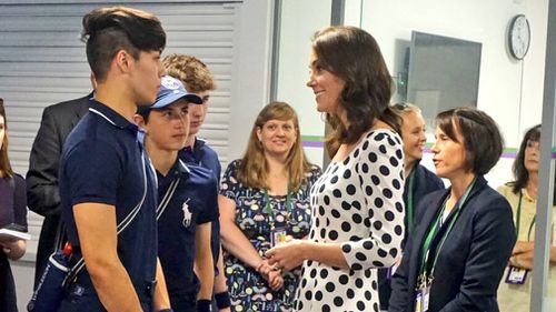 The royal met with ball boys and girls before competition began. (Twitter)