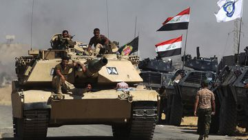 Iraqi forces take position on a road as they advance towards Al-Ayadiah village, the last remaining active front line near Tal Afar, during an operation to retake the city from the Islamic State (AHMAD AL-RUBAYE / AFP).