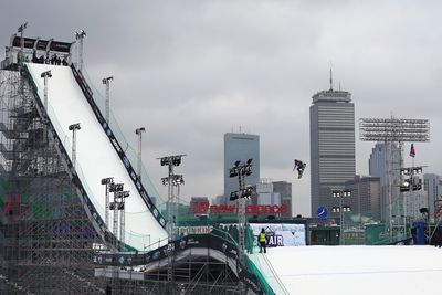 A skier makes a practice jump. The Wednesday practice session coincided with Truck Day, where a few hardy Red Sox fans watched the team's gear loaded ahead of spring training at Fort Myers in Florida.