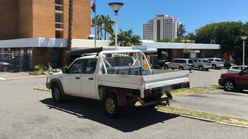 Man found with mystery injuries next to ute outside pub